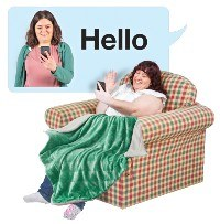 Woman looking at her phone screen and waving hello. A text bubble shows another woman checking her phone with the word hello